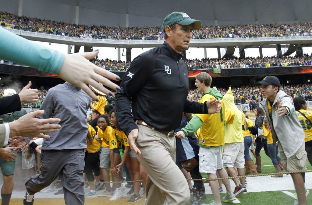 Baylor Bears head coach Art Briles runs through the line during introductions before a game against the TCU Horned Frogs at McLane Stadium in Waco on Saturday, October 11, 2014. (Vernon Bryant/The Dallas Morning News) 11012014xSPORTS
