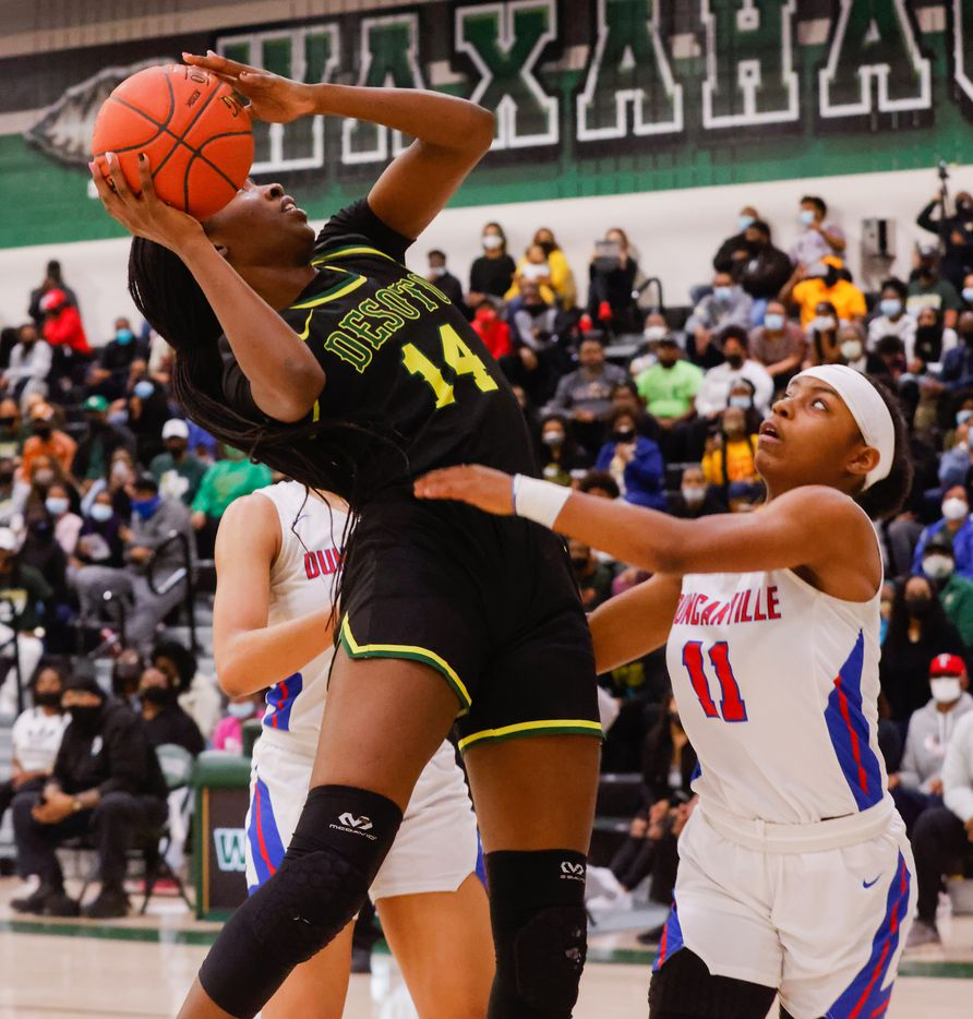 DeSoto's Amina Muhammad (14) attempts a shot against Duncanville's Tristen Taylor (11) during the second half of a girls basketball Class 6A Region II UIL game against DeSoto in Waxahachie on Tuesday, March 2, 2021. DeSoto won the game 52-39. (Juan Figueroa/ The Dallas Morning News)