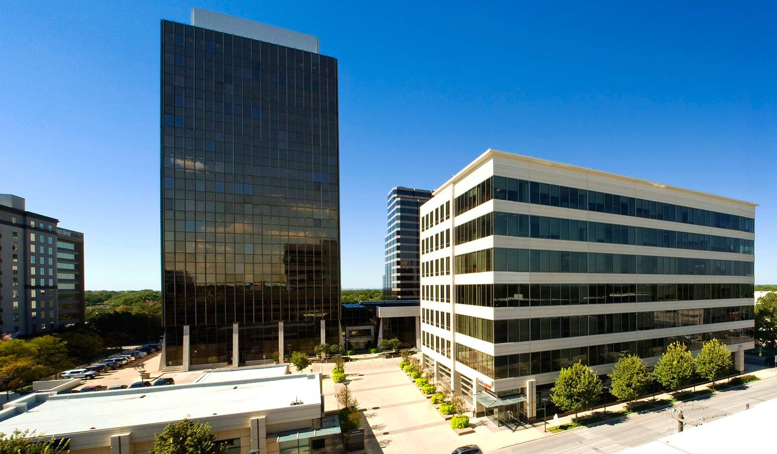 Three Preston Center buildings on Douglas Avenue with almost 400,000 square feet changed hands.