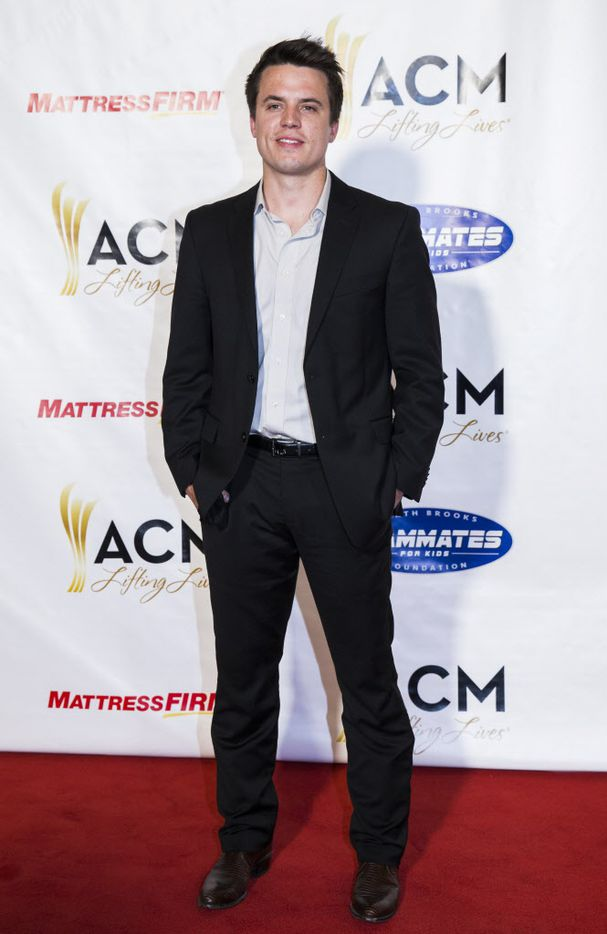 Country music artist Josh Dorr poses for photos on the red carpet at the ACM Lifting Lives gala.