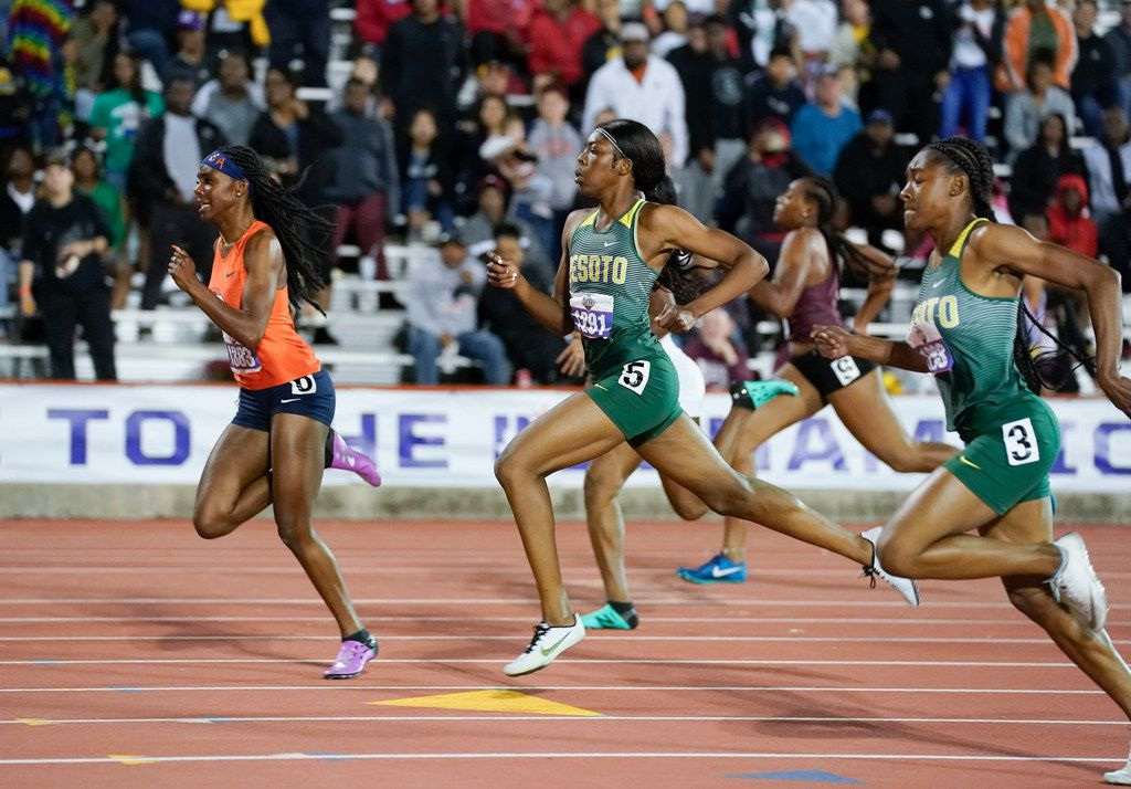 DeSoto's Jayla Hollis (1293) and Rosalie Effiong (1291) head to the finish behind winner  aila Owens of Fort Bend Bush in the girls 200-meter dash at the UIL state track meet in Austin on May 11, 2019. Effiong and Hollis finished second and third respectively. (Bob Daemmrich/Special Contributor)