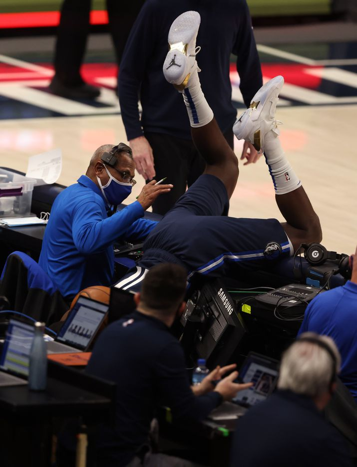 Dallas Mavericks forward Tim Hardaway Jr. (11) falls over after diving for a loose ball in a game against the Phoenix Suns during the first quarter of play at American Airlines Center on Monday, February 1, 2021in Dallas. (Vernon Bryant/The Dallas Morning News)