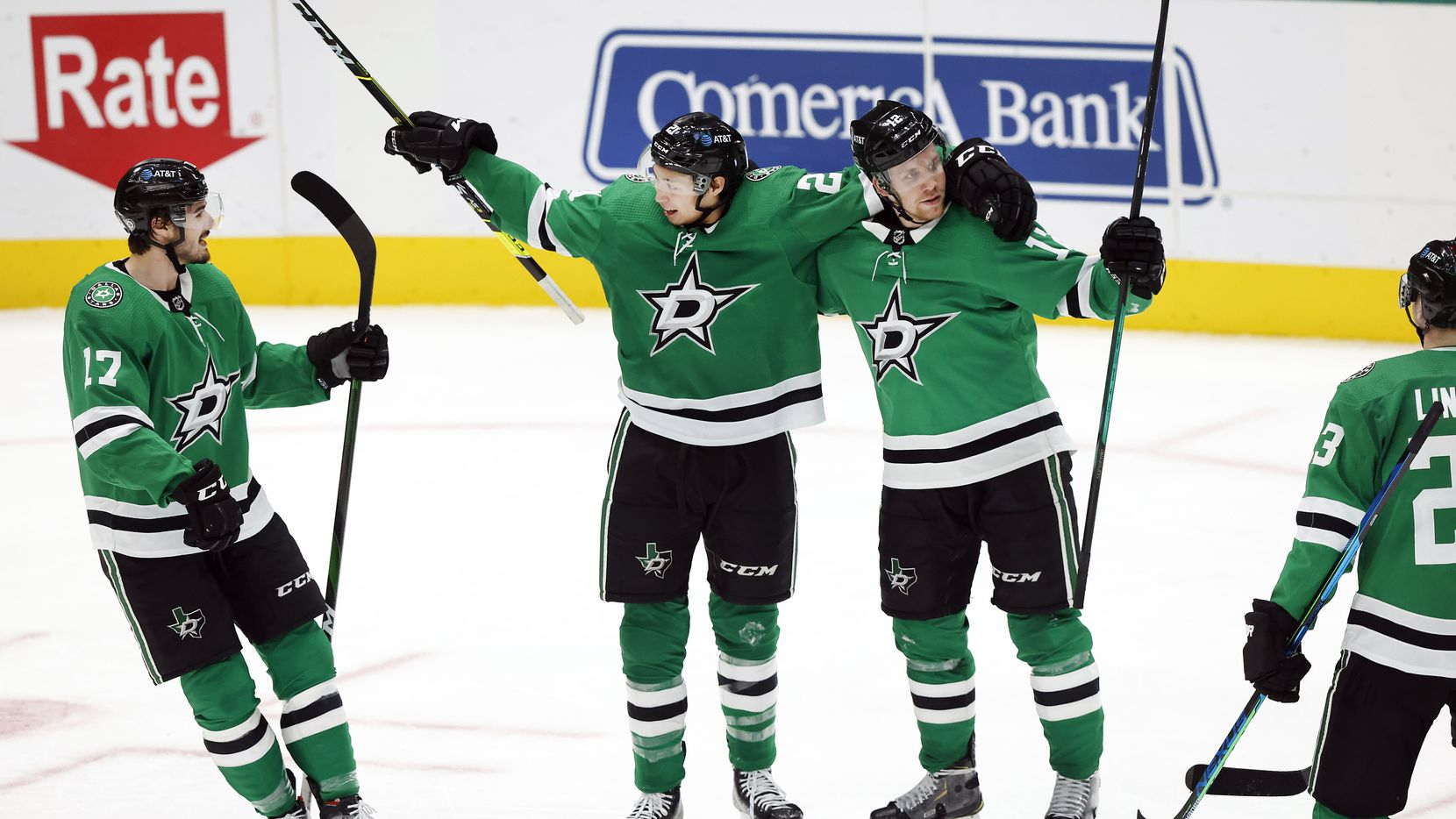 Dallas Stars left wing Jason Robertson (21) is congratulated by his teammates after scoring a third period goal against the Columbus Blue Jackets at the American Airlines Center in Dallas, Thursday, March 4, 2021. The Stars fell though to the Blue Jackets, 3-2.
