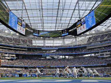 The Los Angeles Chargers run a play deep in their own territory against the Dallas Cowboys in the third quarter at SoFi Stadium in Inglewood, California, Sunday, September 19, 2021. The Cowboys won, 20-17.