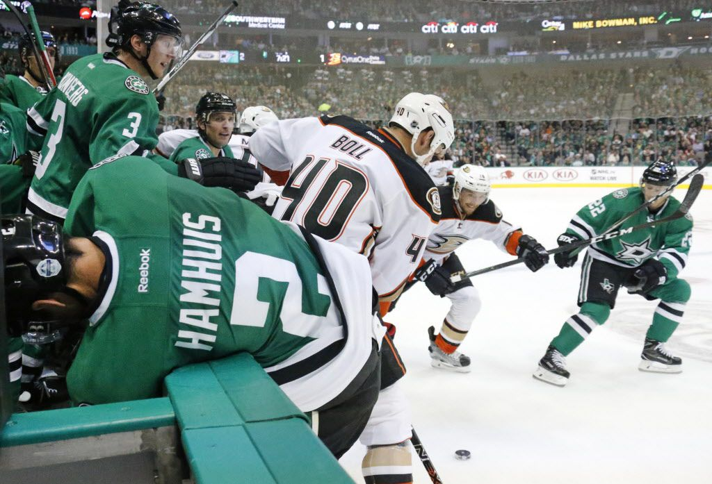 Dallas Stars defenseman Dan Hamhuis (2) gets knocked into the Stars bench by Anaheim Ducks right wing Jared Boll (40) in the second period during the Anaheim Ducks vs. the Dallas Stars NHL hockey game at the American Airlines Center on Thursday, October 13, 2016. (Louis DeLuca/The Dallas Morning News)