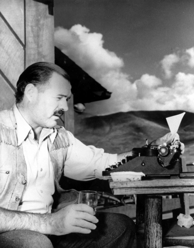 American novelist and short-story writer Ernest Hemingway at his typewriter as he works at Sun Valley Lodge, Idaho, in 1939.