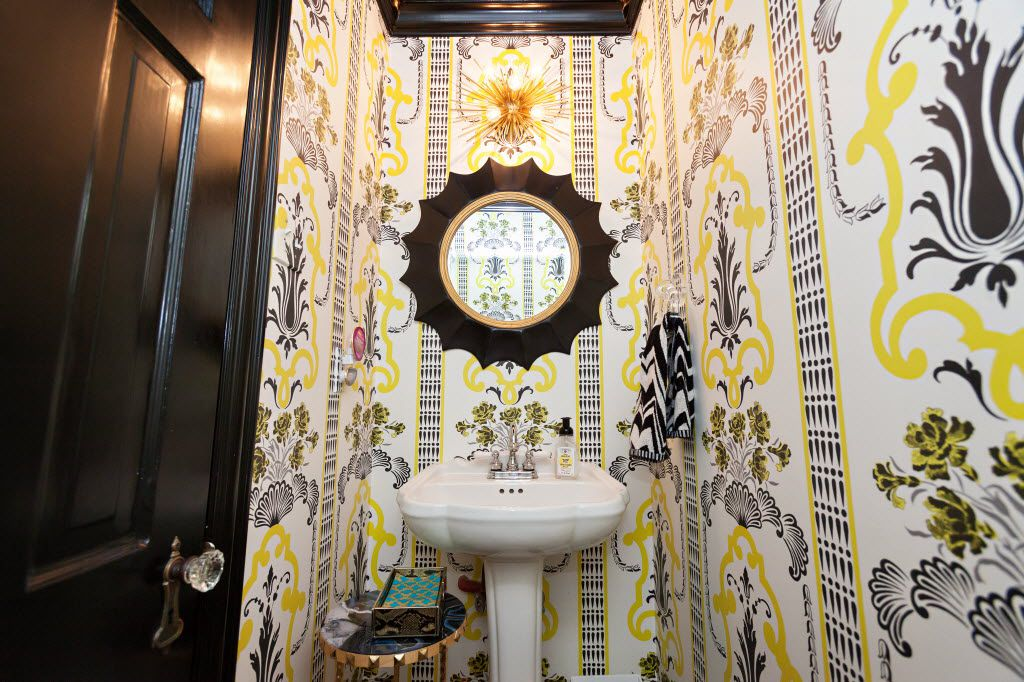 A tiny powder bath gets a serious shot of style with wallpaper Lauren Renfrow picked, with the help of designer Abbe Fenimore. (Melanie Johnson Photography)
