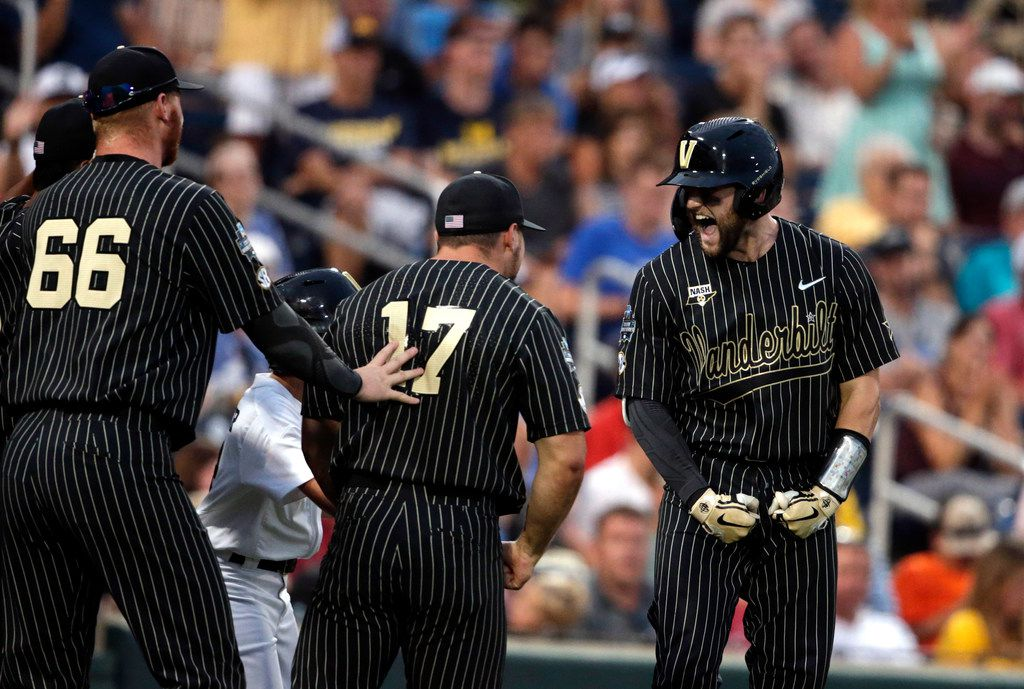 Vanderbilt's Philip Clarke, right, celebrates his solo homer in the seventh inning against Michigan in Game 2 of the NCAA College World Series baseball finals in Omaha, Neb., Tuesday, June 25, 2019. (AP Photo/Nati Harnik)
