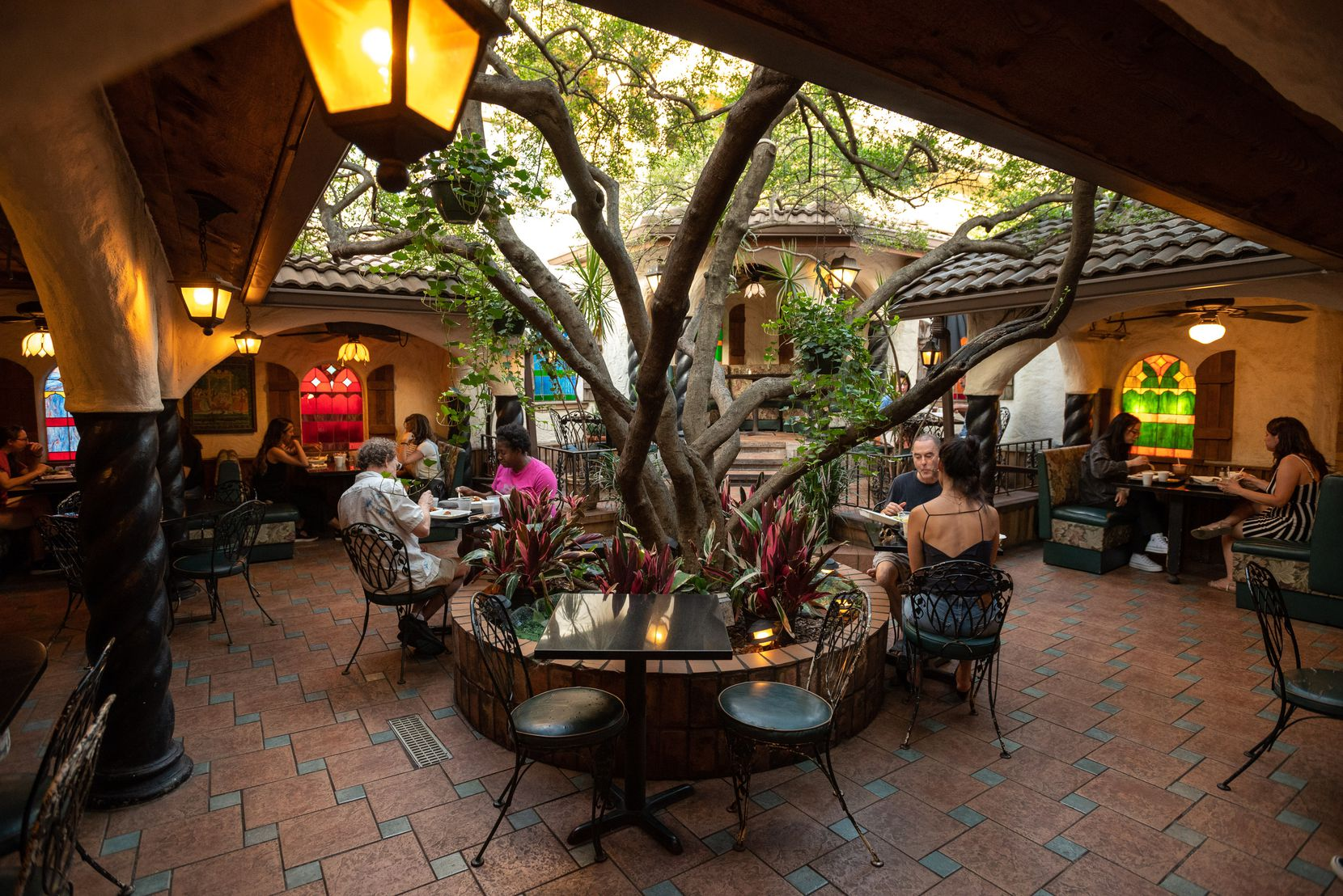 Diners outside in the patio area at Kalachandji's vegetarian restaurant on Gurley Avenue in east Dallas, on Saturday, Aug. 28, 2021. Kalachandji's is one of Dallas' last buffets.