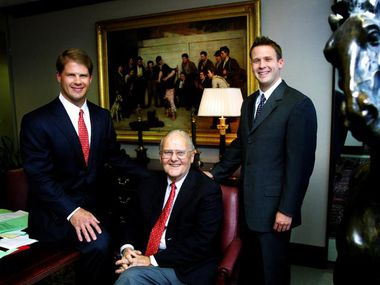 Lamar Hunt poses with his sons Clark (left) and Dan at the offices of Hunt Sports Group in Dallas in April 2003. Clark and Dan Hunt help their father manage the family's interests, which include the Kansas City Chiefs and FC Dallas.