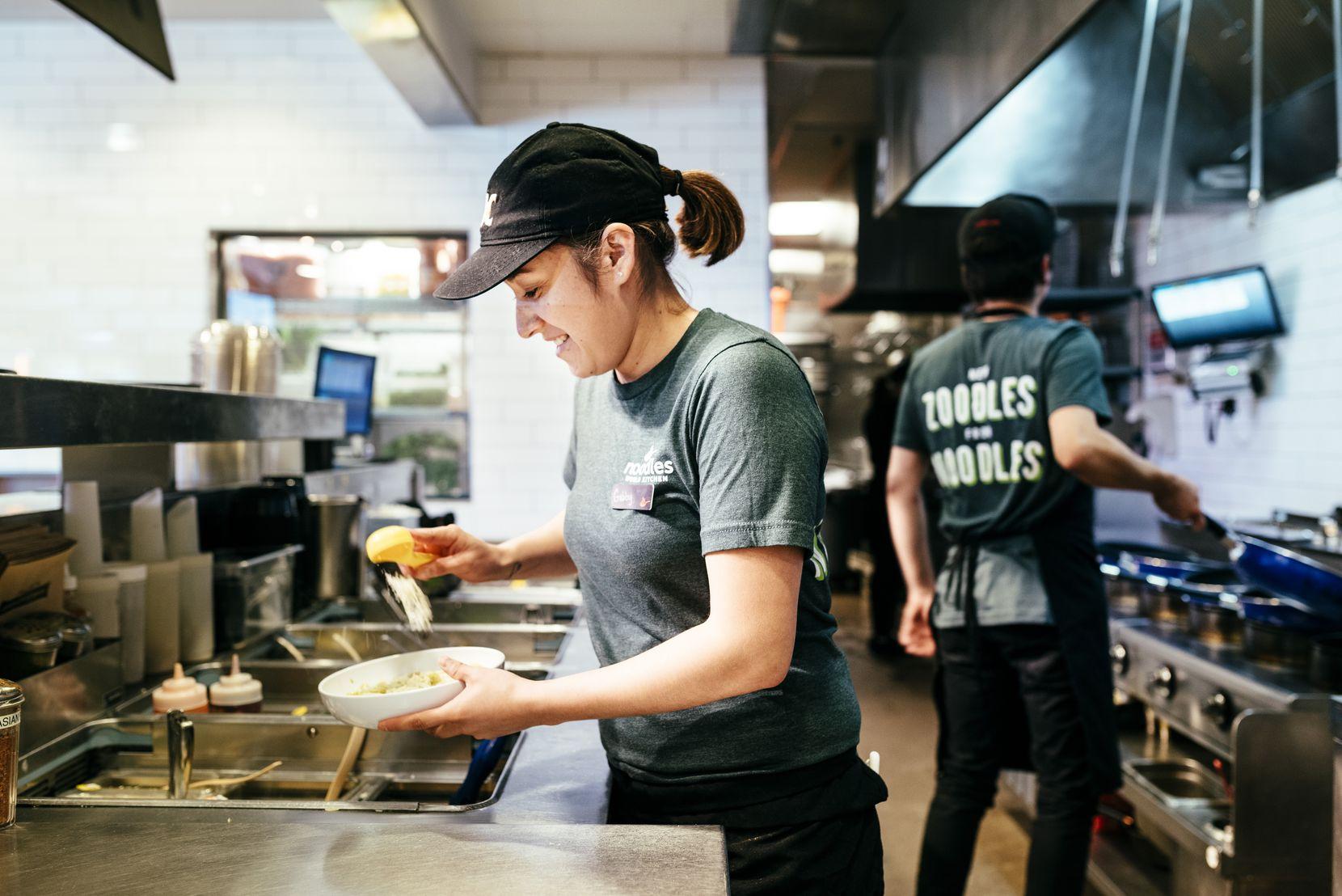 A Noodles & Company team member preps food at a Denver-area restaurant.