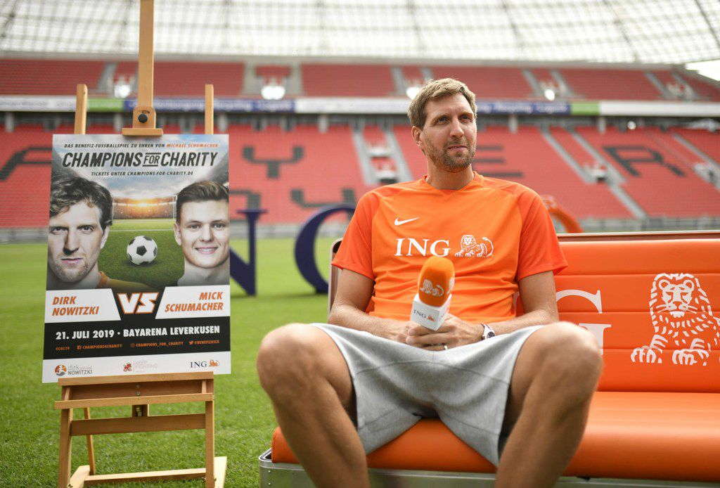 "German basketball legend Dirk Nowitzki attends a news conference to promote the ""Champions for Charity"" event in Leverkusen, western Germany on Juli 3, 2019. - Nowitzki plays in the third edition of the charity event ""Champions for Charity"" taking place on July 21, 2019 in the BayArena stadium of Leverkusen against a team around Mick Schumacher, son of German Formula One legend Michael Schumacher, which will benefit the ""Dirk Nowitzki Foundation"" and the ""Keep Fighting"" initiative of the Schumacher family. (Photo by Ina FASSBENDER / AFP)INA FASSBENDER/AFP/Getty Images"