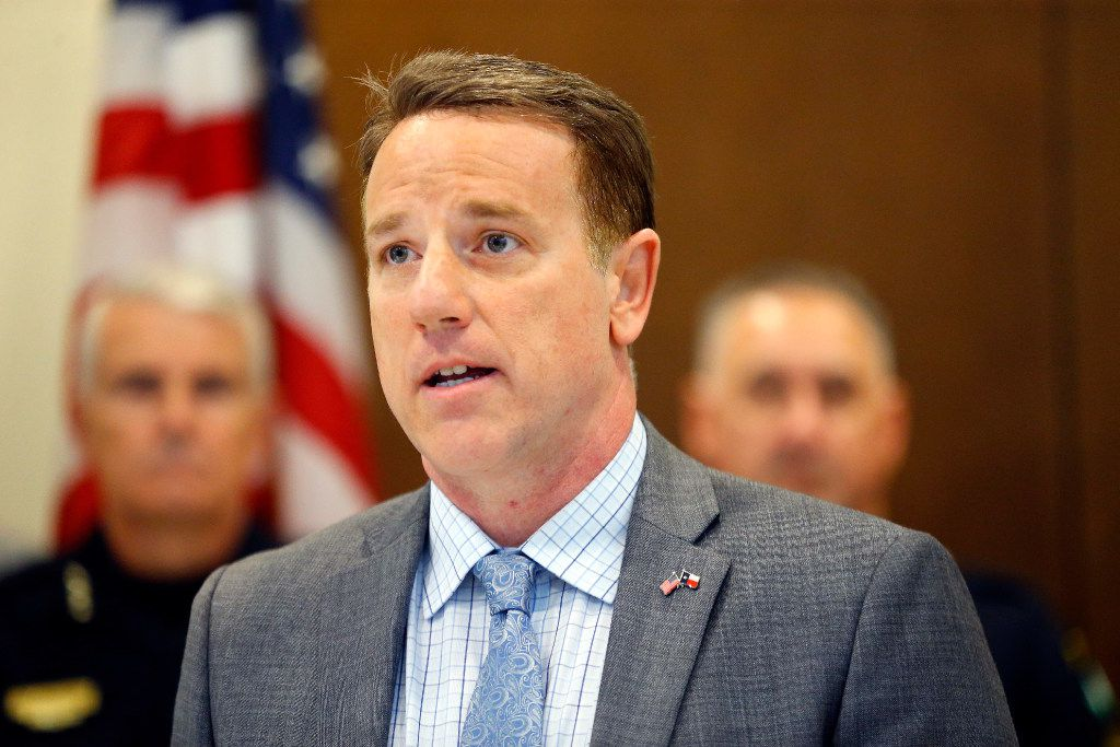 Texas Representative Pat Fallon of Dist. 106 announced his bill that would provide a property tax exemption to surviving spouses of first responders killed in the line of duty during a press conference at the Little Elm Safety Center in Little Elm, Texas, Thursday, March 2, 2017. House Bill 2524 and House Joint Resolution 88 are in memory of fallen Little Elm police detective Jerry Walker. Flanking him were representative of local police departments, Little Elm Mayor David Hillock and Police Chief Rodney Harrison.