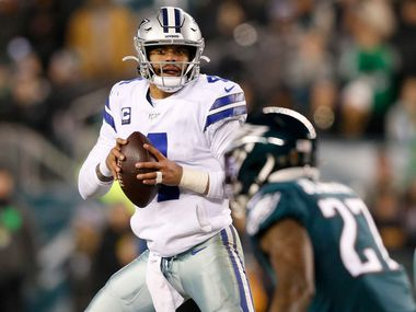 Dallas Cowboys quarterback Dak Prescott (4) scans the field looking for an open receiver in a game against the Philadelphia Eagles during the first half of play at Lincoln Financial Field in Philadelphia on Sunday, December 22, 2019.