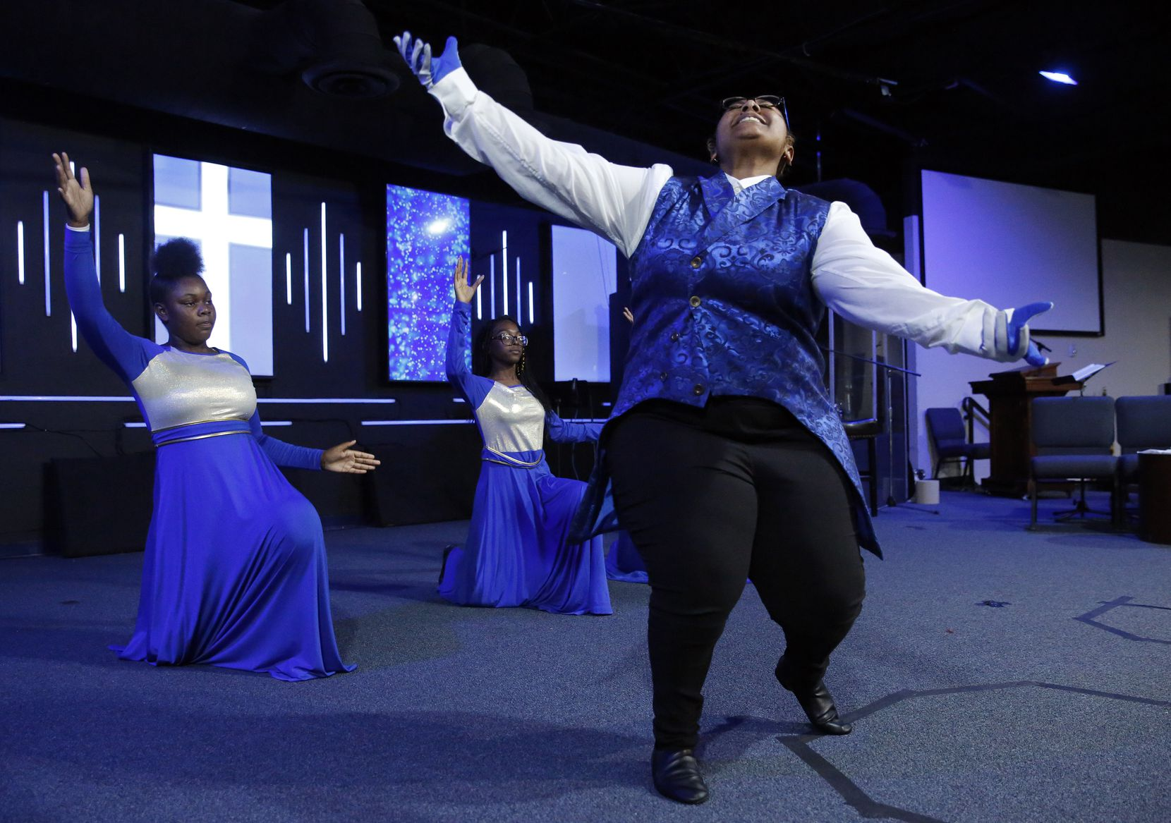 """Daisy Herron (right), among the members of The Restored dance ministry, runs through a rehearsal with Ashleigh Pruitt Turner (left) and Jai'lah Yarbrough. They taped their """"Glory to the Lord"""" performance for the Sunday worship service."""