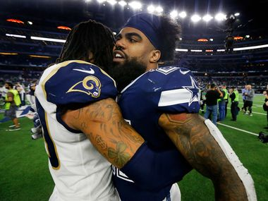 Los Angeles Rams running back Todd Gurley (30) congratulates Dallas Cowboys running back Ezekiel Elliott (21) on their win at AT&T Stadium in Arlington, Texas, Sunday, December 15, 2019.