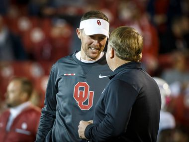 Oklahoma head coach Lincoln Riley chats with TCU head coach Gary Patterson before an NCAA football game in Norman, Okla., Saturday, Nov. 11, 2017.