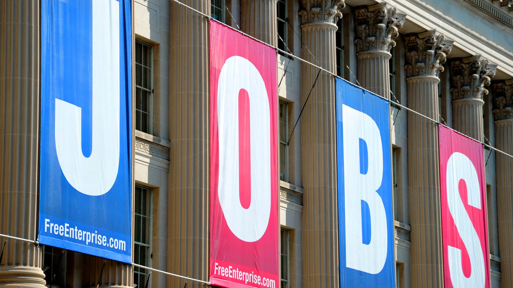 A large jobs sign is displayed above the U.S. Chamber of Commerce in Washington, D.C.