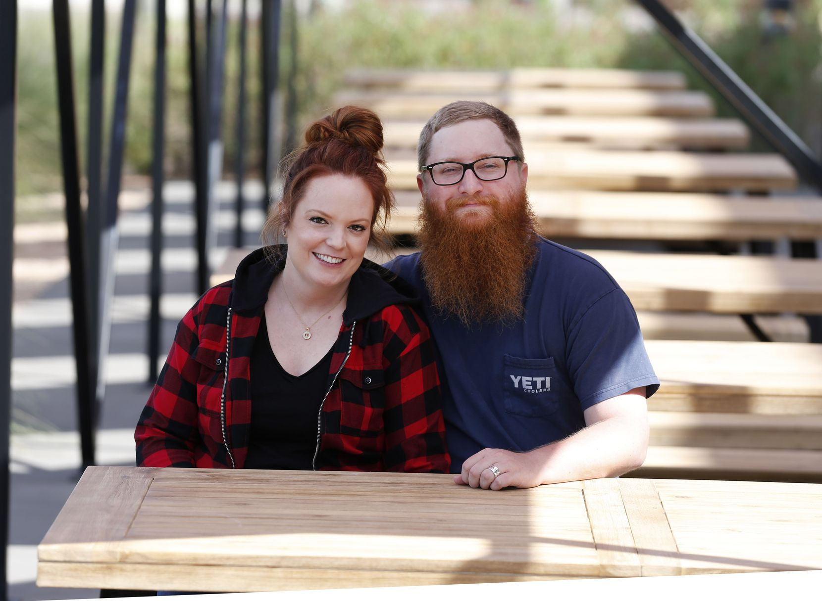 Travis and Emma Heim sit on the patio of their new Dallas restaurant at 3130 W. Mockingbird Lane. It's across the street from Dallas Love Field.