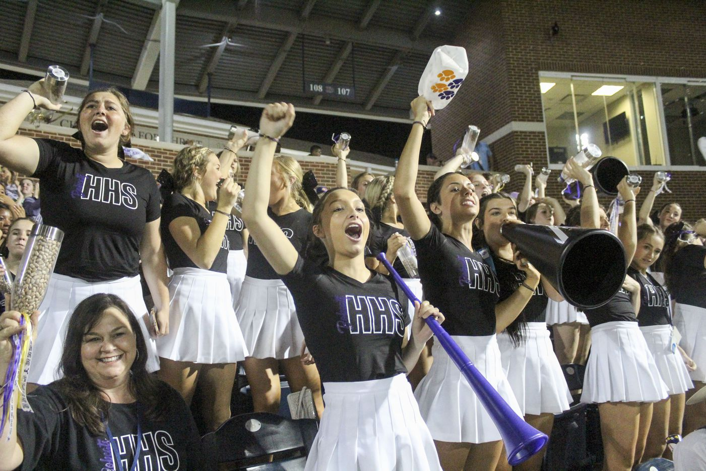 Hallsville High School cheerleaders celebrate a hit during game two of the UIL baseball 5A Region II final series against Frisco Wakeland at Horner Ballpark in Dallas on Friday, June 4, 2021. (Elias Valverde II / Special Contributor)