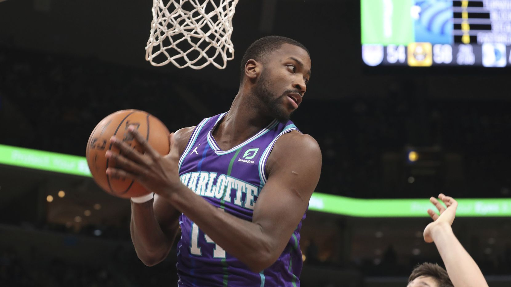 Charlotte Hornets forward Michael Kidd-Gilchrist (14) grabs a rebound in the first half of an NBA basketball game against the Memphis Grizzlies, Sunday, Dec. 29, 2019, in Memphis, Tenn.