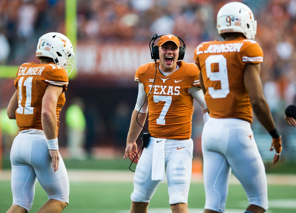 Texas Longhorns quarterback Shane Buechele (7), quarterback Sam Ehlinger (11) and wide receiver Collin Johnson (9) celebrate a touchdown during the fourth quarter of a college football game between the University of Texas and West Virginia on Saturday, November 3, 2018 at Darrell Royal Memorial Stadium in Austin, Texas. (Ashley Landis/The Dallas Morning News)