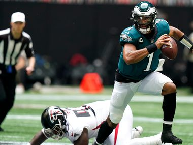 Philadelphia Eagles quarterback Jalen Hurts (1) breaks out of the pocket against the Atlanta Falcons during the first half of an NFL football game, Sunday, Sept. 12, 2021, in Atlanta. (AP Photo/Brynn Anderson)