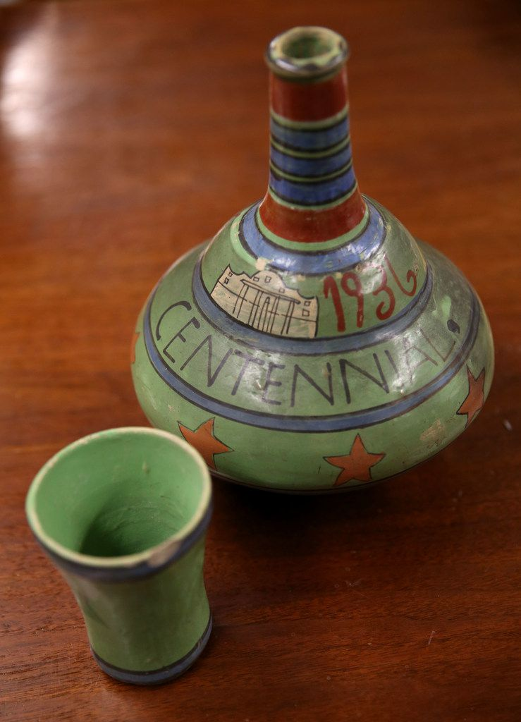 A hand-painted clay water jug souvenir from the Texas Centennial Exposition in 1936.