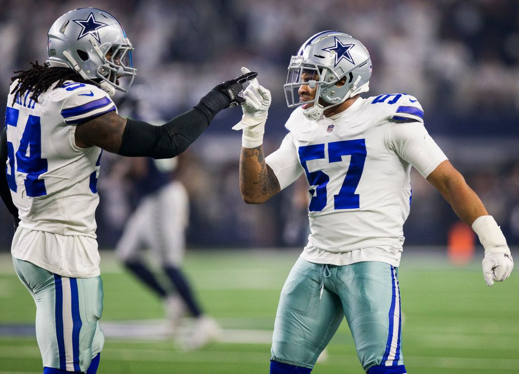 FILE - Cowboys middle linebacker Jaylon Smith (54) and outside linebacker Damien Wilson (57) celebrate after running Seahawks quarterback Russell Wilson (3) off the sideline during the first quarter of a wild-card playoff game on Saturday, Jan. 5, 2019 at AT&T Stadium in Arlington. (Ashley Landis/The Dallas Morning News)