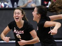 Flower Mound Marcus' Maggie Cox (left) reacts along with teammate Rachel Sturton after Cox scored a point to win the third set in Tuesday's five-set win over Flower Mound, ranked No. 1 in the state in Class 6A. (Steve Hamm/Special Contributor)