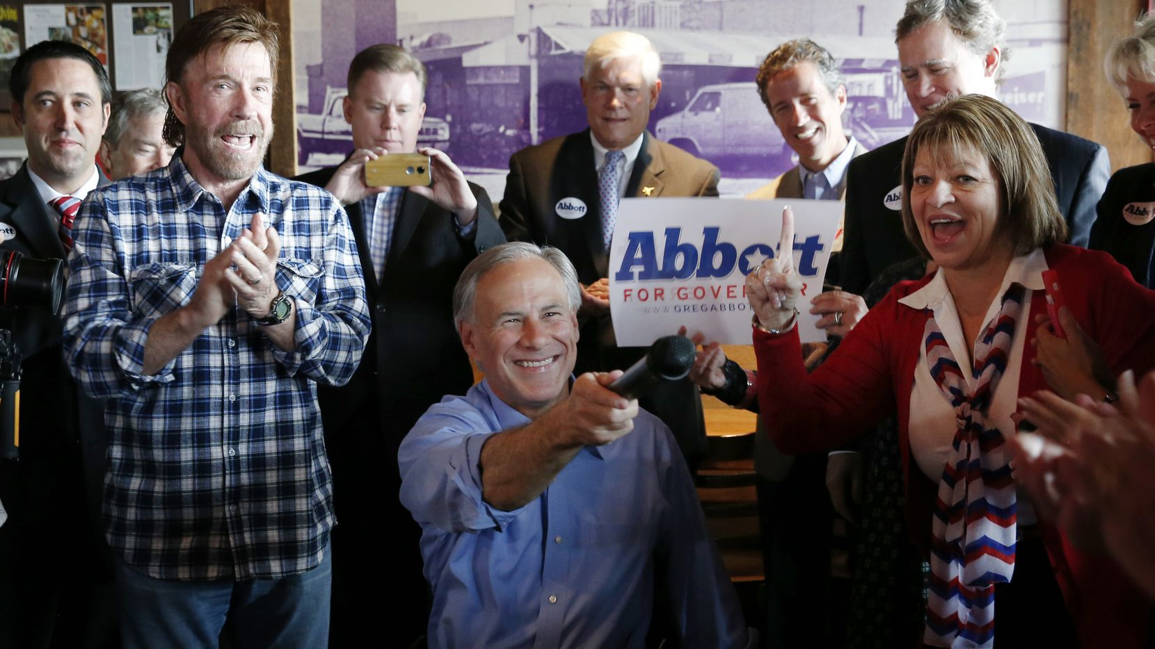 Greg Abbott, campaigning for governor with Chuck Norris (left) in Dallas in November 2014, said he doesn't see Texas breaking with the U.S. the way Britain voted to leave the European Union last week.