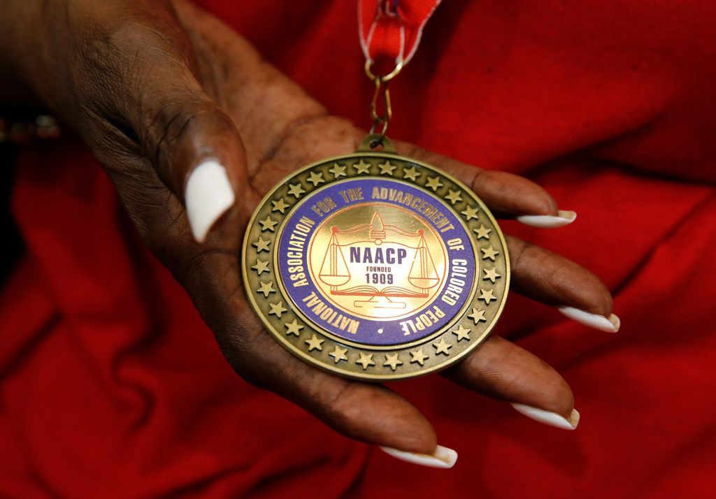 Detail of a medal Daisy Garner received from the NAACP for her husband Willie B. Ludden Jr. during his memorial service at Evergreen Memorial Funeral Home in Dallas on Tuesday
