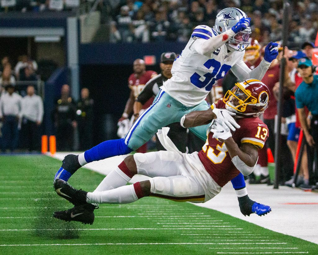 Dallas Cowboys strong safety Jeff Heath (38) tackles Washington Redskins wide receiver Kelvin Harmon (13) during the end of the second quarter in the NFL game on Sunday, Dec. 29, 2019 at AT&T Stadium in Arlington, Texas. (Lynda M. Gonzalez/The Dallas Morning News)