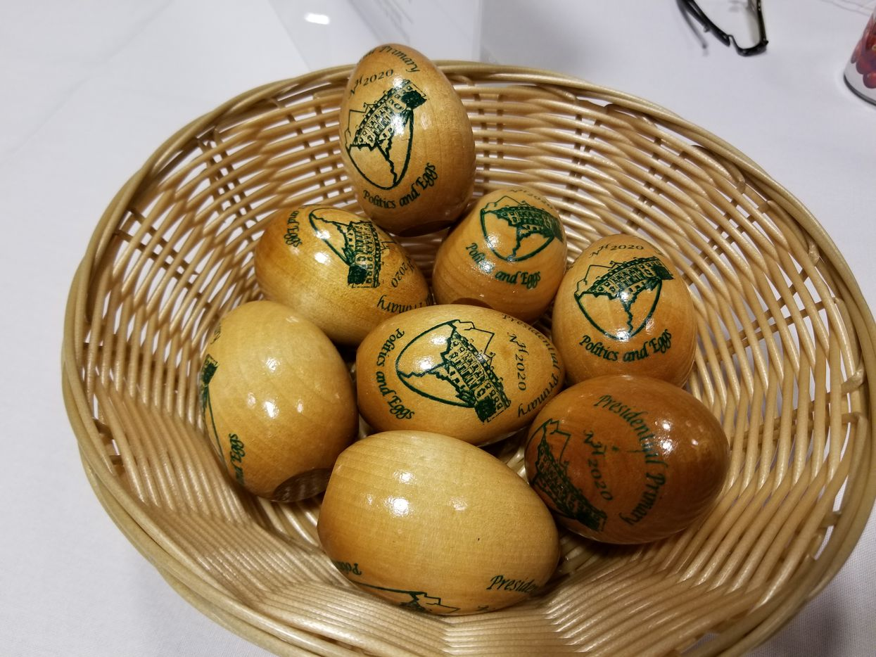 Souvenir wooden eggs at the Politics & Eggs breakfast on Wednesday, Jan. 16, 2019, for guests waiting to hear Julian Castro at St. Anselm College in Goffstown, N.H. The breakfast was hosted by the college's Institute of Politics and The New England Council, a business group.