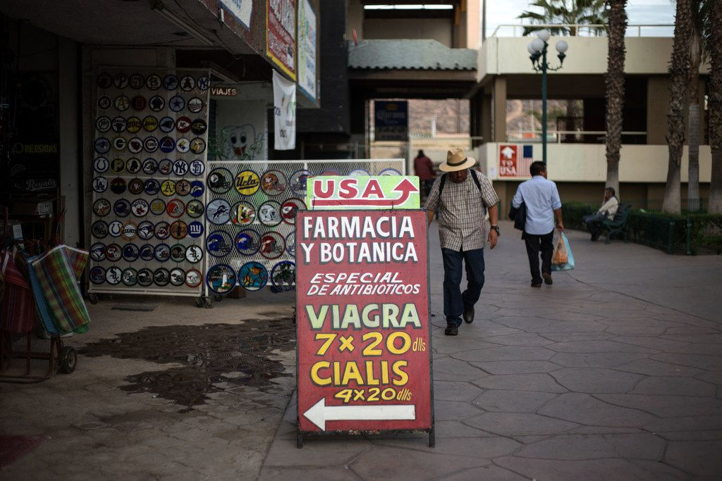 A sign outside a pharmacy in Tijuana, Mexico, entices American tourists with prescription drugs at discount prices.