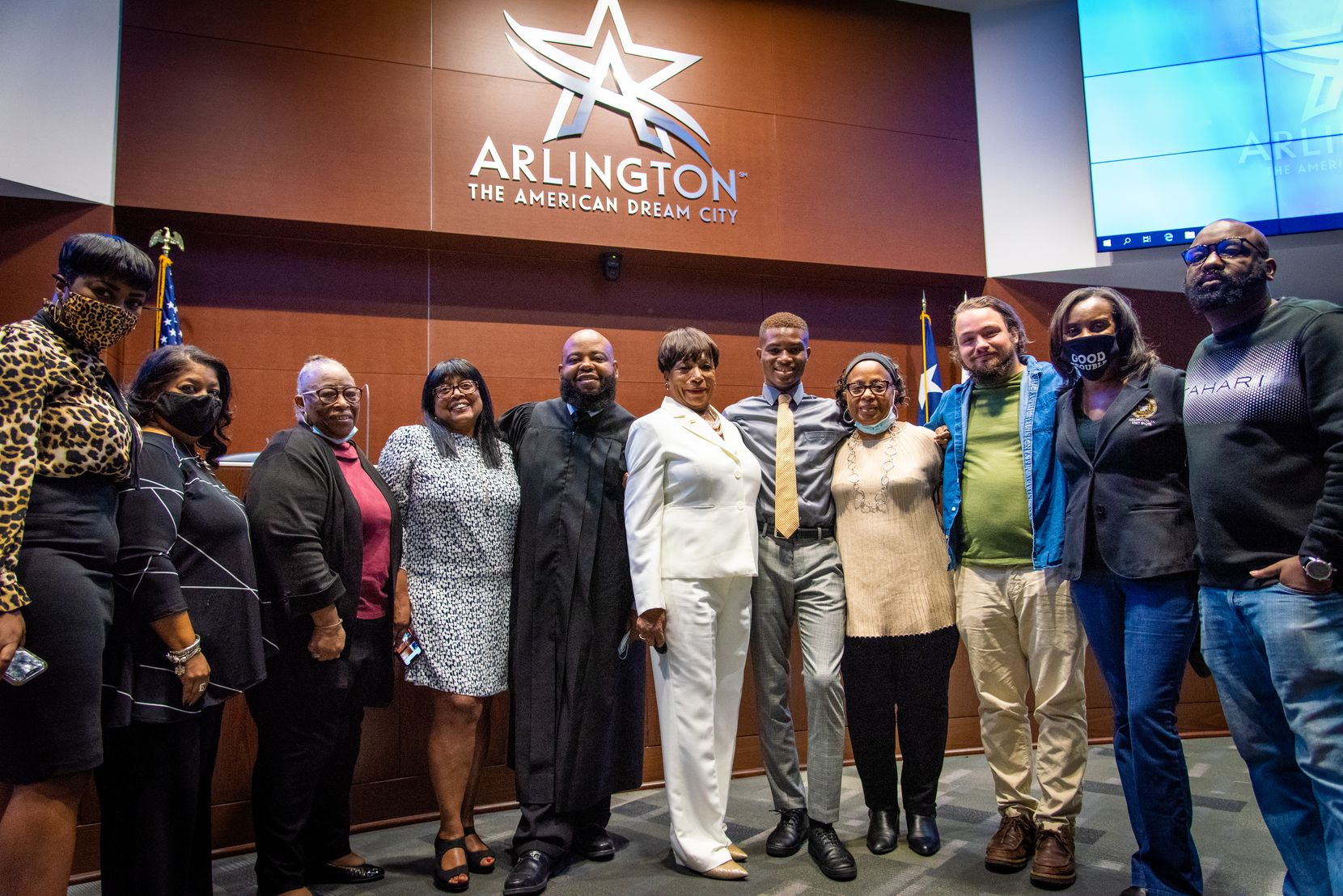 Ruby Faye Woolridge, Arlington City Council District 6 member, and Stefan Powdrill, Sam Houston High School student, attended her swearing-in ceremony with other members of the campaign.