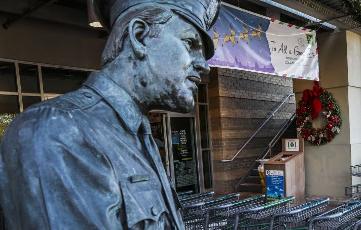 A statue of a police officer writing a citation is stationed outside the the Central Market store on Lovers Lane in Dallas.
