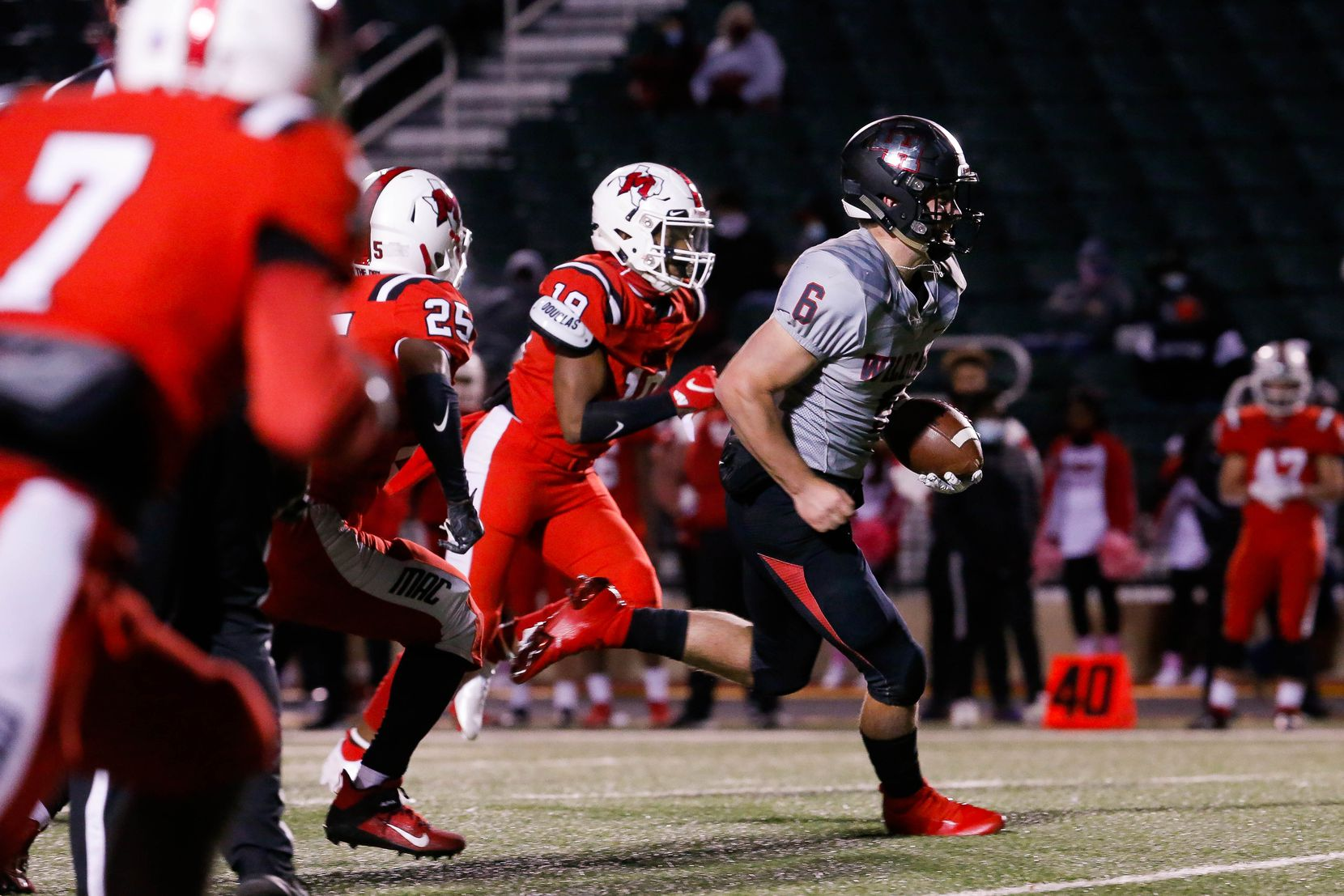 Lake Highlands quarterback Mitch Coulson (6) slips past the Irving MacArthur defense for a touchdown during the fourth quarter of a high school football game at Joy & Ralph Ellis Stadium in Irving on Friday, Oct. 23, 2020. (Juan Figueroa/ The Dallas Morning News)