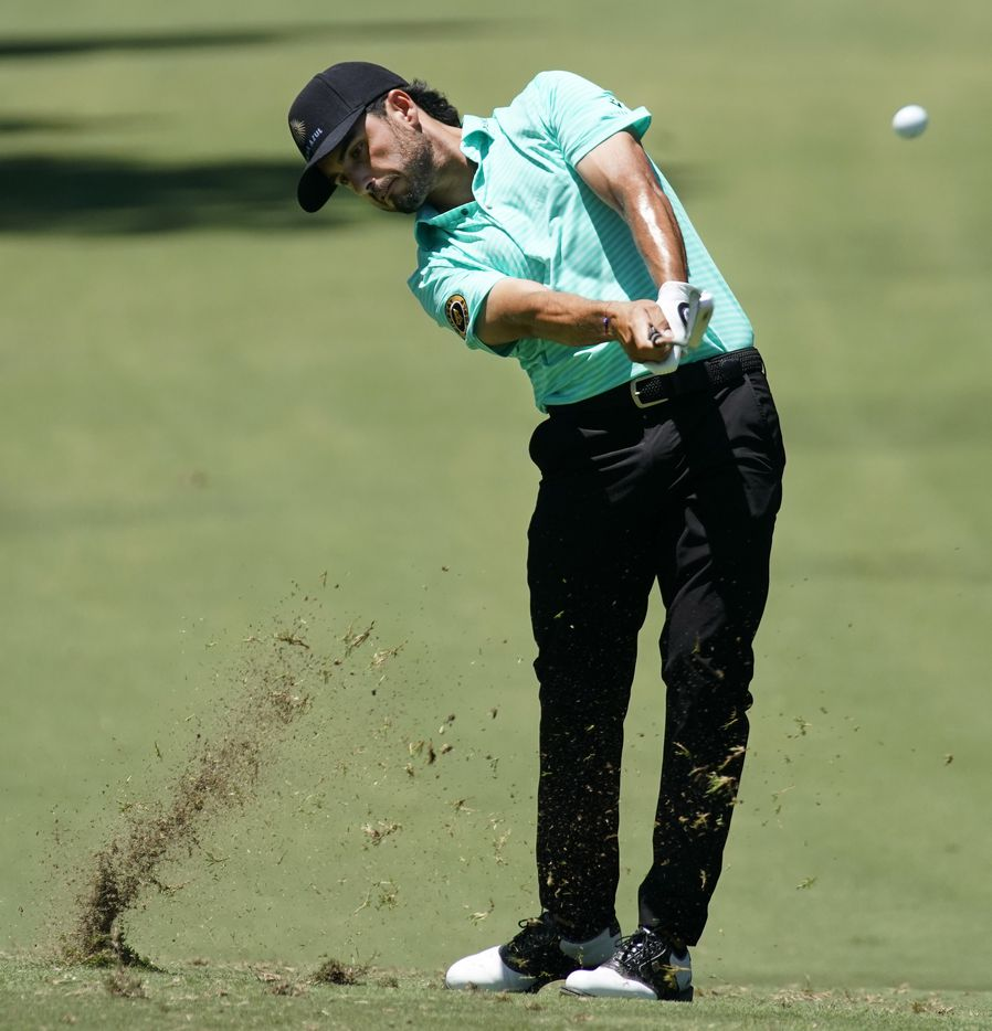 PGA Tour golfer Abraham Ancer makes his approach shot on No. 18 during the opening round of the Charles Schwab Challenge at the Colonial Country Club in Fort Worth, Thursday, June 11, 2020.  The Challenge is the first tour event since the COVID-19 pandemic began. (Tom Fox/The Dallas Morning News)