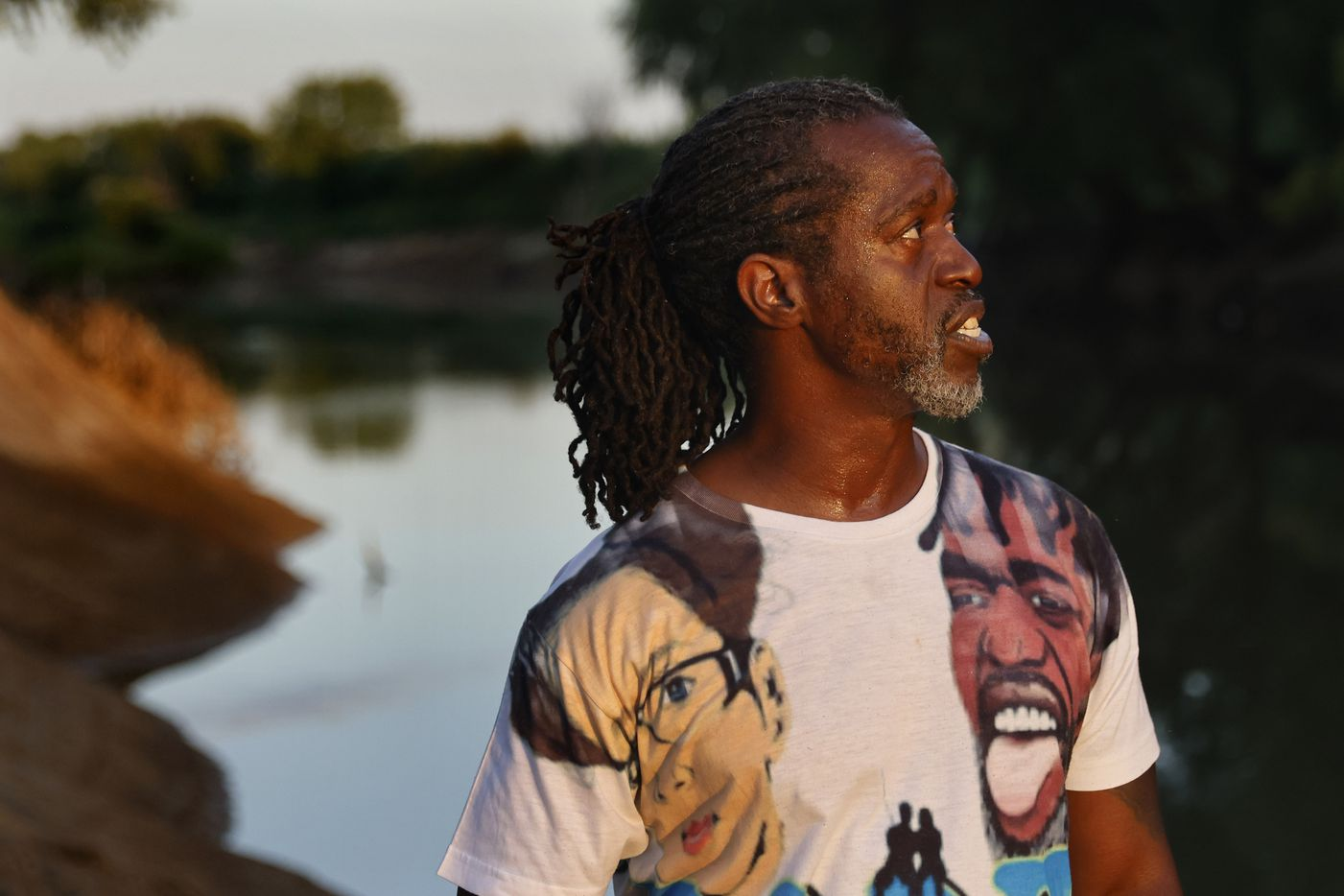 Wearing a t-shirt with he and his wife Beverly Rasnick pictured, Odell Allen watches his line for an alligator gar bite on the Trinity River, Monday, August 30, 2021. (Tom Fox/The Dallas Morning News)