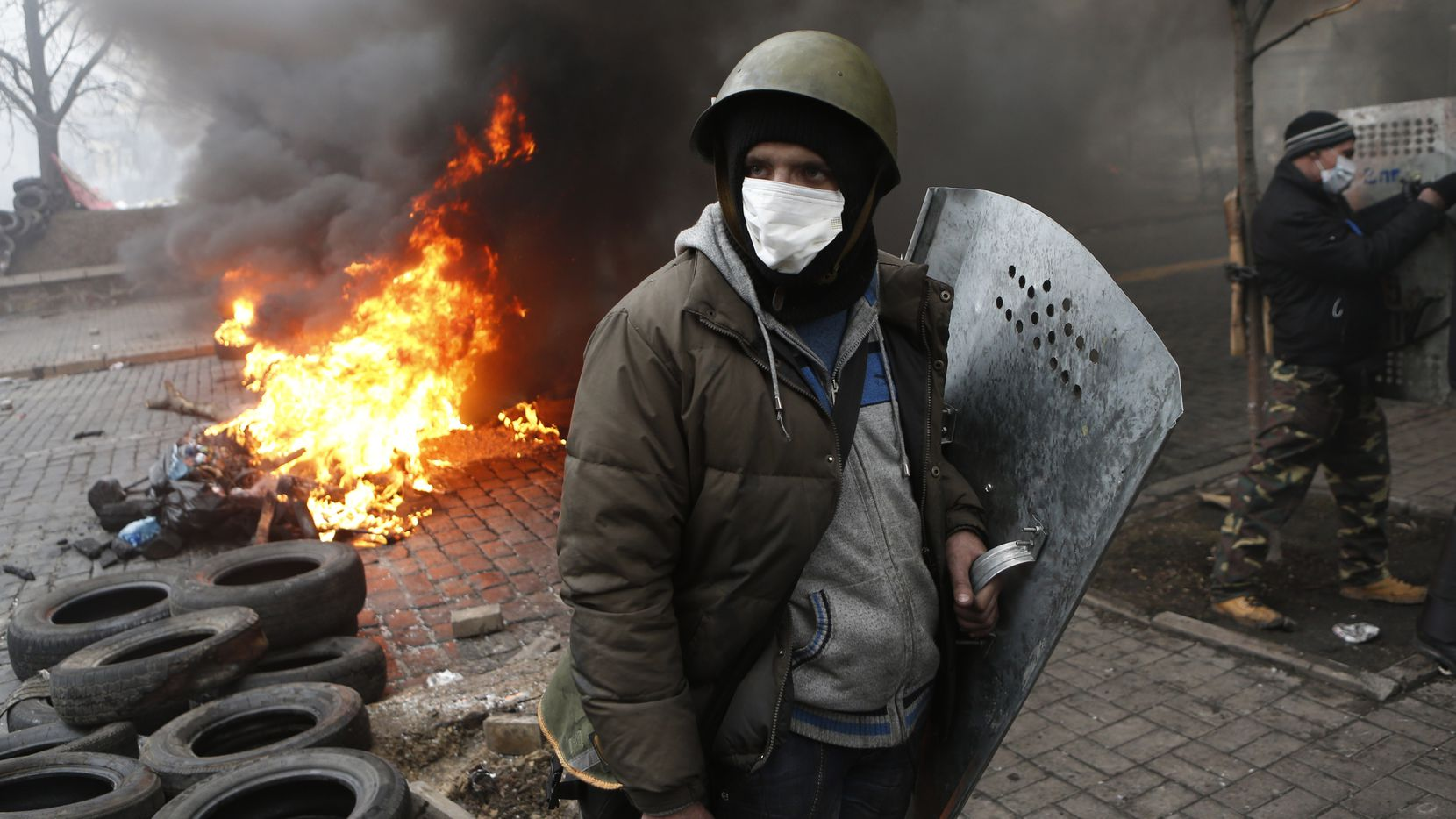 Anti-government protesters man a barricade in central Kiev, Ukraine, Thursday, Feb. 20, 2014.