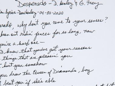 "Don Henley and Glenn Frey's handwritten lyrics to the Eagles' ""Desperado"" sold for $33,600 at a charity auction held by Heritage Auctions on May 13."