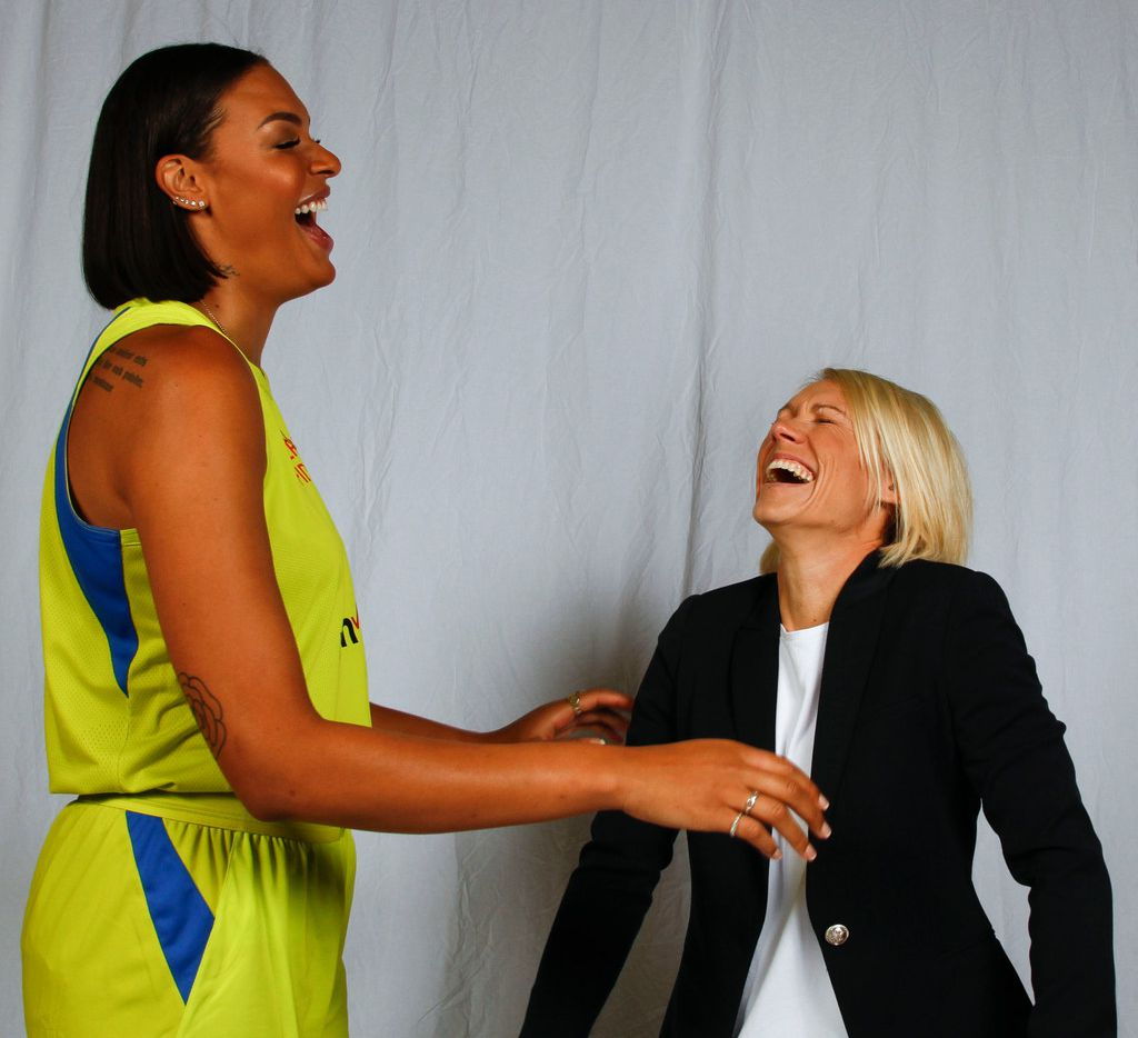 Dallas Wings center Liz Cambage (8) and assistant coach Erin Phillips share a laugh as they pose for a photo during the team's Media Day at the College Park Center on the UT Arlington campus Friday, May 4, 2018. (Ron Baselice/The Dallas Morning News)