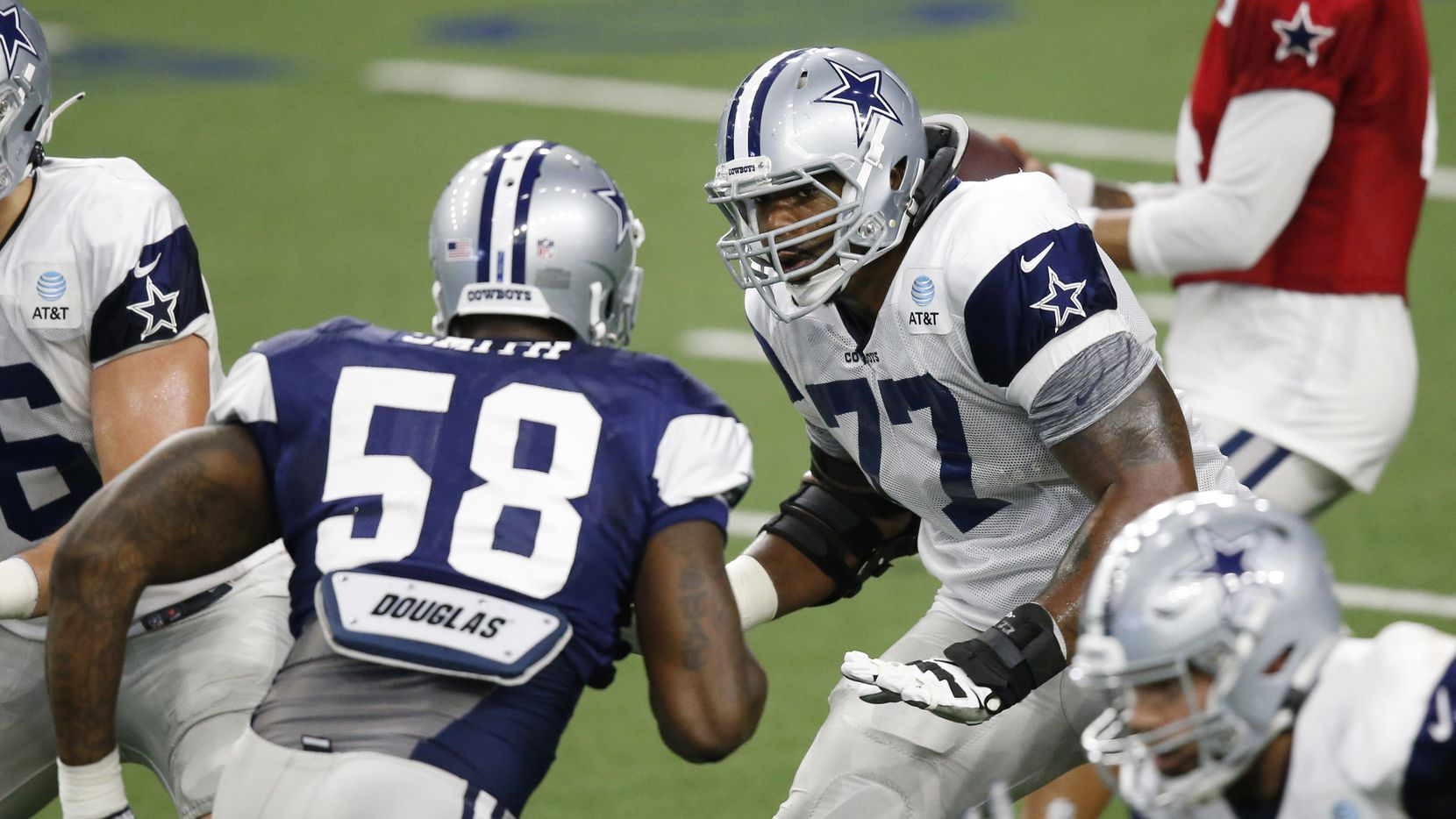 Dallas Cowboys offensive tackle Tyron Smith (77) looks to block Dallas Cowboys defensive end Aldon Smith (58) during training camp inside the Ford Center at the Dallas Cowboys headquarters at The Star in Frisco, Texas on Tuesday, August 18, 2020.