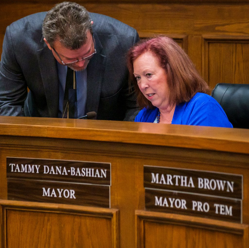Mayor Tammy Dana-Bashian talks with City Manager Brian Funderburk after Rowlett officials approved a new deal to acquire a 119-acre tract of the Bayside property along Lake Ray Hubbard, as a step toward enabling a new developer to take over the project, at Rowlett City Council chambers on Thursday, Aug. 1, 2019, in Rowlett, Texas. Bayside is a City of Rowlett planned development which will feature a Crystal Lagoon, a beach and show fountain, and has been in legal limbo for months.