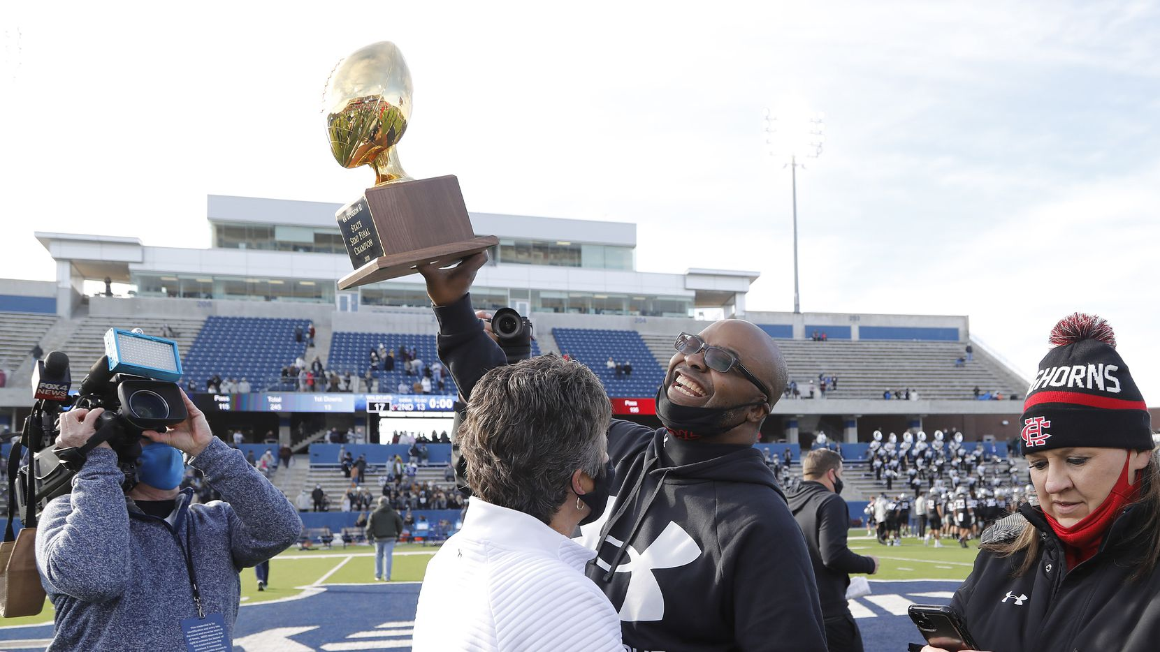 Cedar Hill High School head coach Carlos Lynn hoists the trophy after the win as Denton Guyer High School played Cedar Hill High School in the Class 6A Division II, state semifinal at McKinney ISD Stadium in McKinney on Saturday, January 9, 2021.