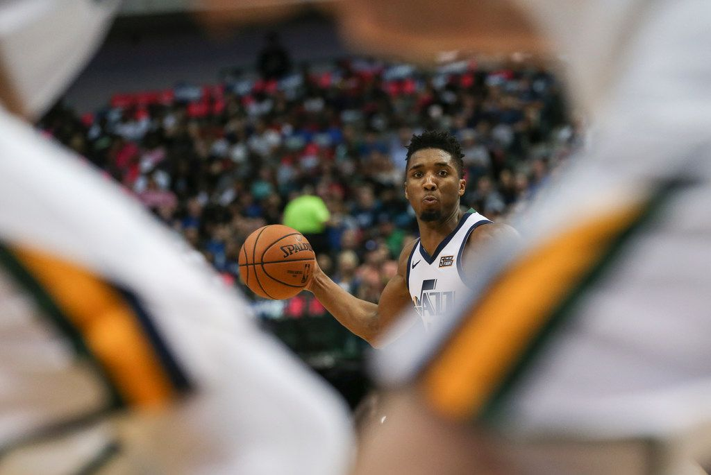 FILE - Jazz guard Donovan Mitchell (45) looks to make a pass during the first half of a game against the Mavericks at American Airlines Center in Dallas on Sunday, Oct. 28, 2018.