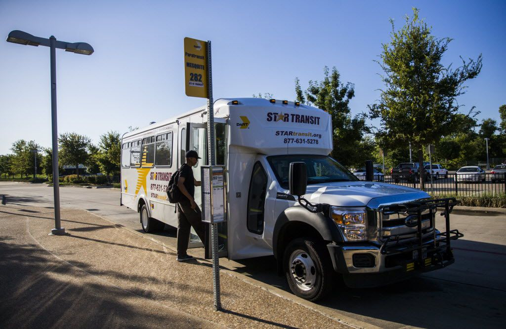 A man boards a STAR Transit bus at the DART Lawnview Station. (Ashley Landis/Staff Photographer)