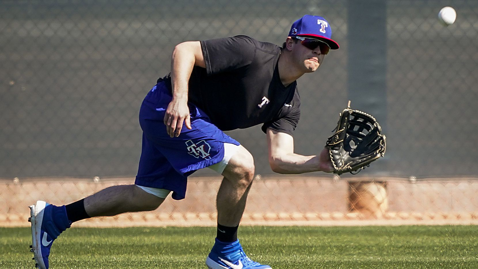 Texas Rangers infielder Nick Solak shags balls in center field during a spring training workout at the team's training facility on Thursday, Feb. 13, 2020, in Surprise, Ariz.