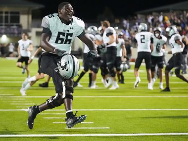 Denton Guyer defensive back Marquan Pope (33) celebrates after the final play in an overtime victory over Denton Ryan in a high school football game on Friday, Sept. 3, 2021, in Denton.